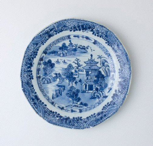 An image of Plate decorated with willow pattern by