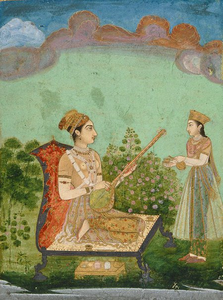 An image of Lady playing a tambura by