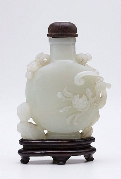An image of Bottle with carved ornament with rocks, peacock and peony by