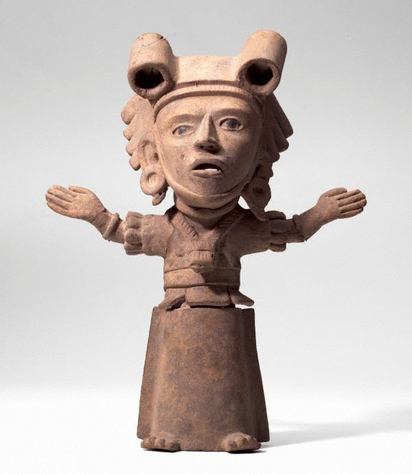 An image of Pottery figure (standing woman with arms outstretched)