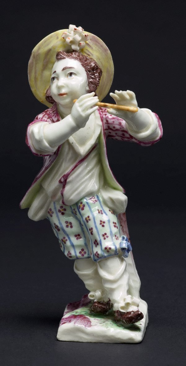 An image of Boy playing the pipe