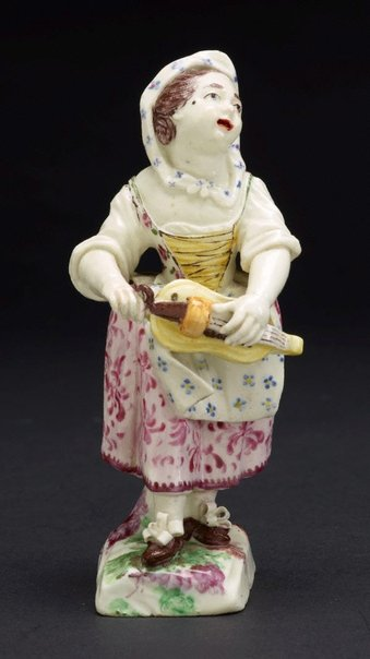 An image of Girl playing the hurdy-gurdy by Mennecy-Villeroy porcelain