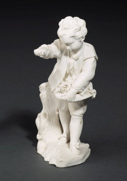 An image of Boy offering flowers by Sèvres