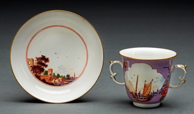 An image of Two handled beaker and saucer