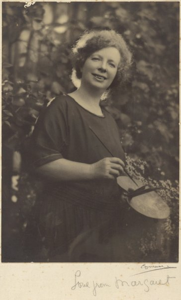 An image of Margaret Preston with her paint palette by Harold Cazneaux