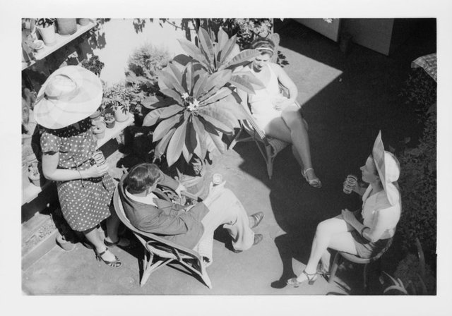 An image of Grace Crowley with Rah Fizelle and friends on Crowley's roof garden, 227 George St, Sydney