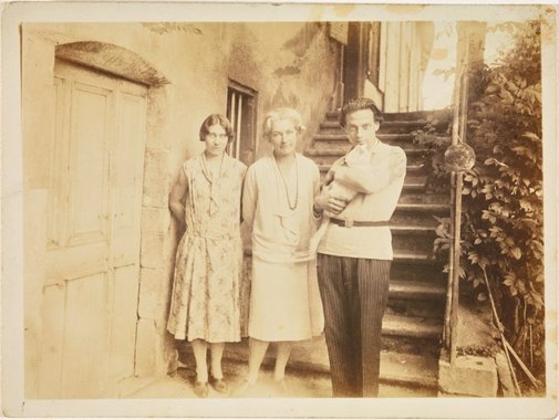 An image of Anne Dangar in between Monsieur and Madame Pouyaud and Poulette the cat at the door of her house in Moly-Sabata, France by Unknown