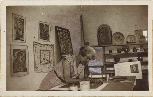 An image of Anne Dangar at work in her studio by Unknown