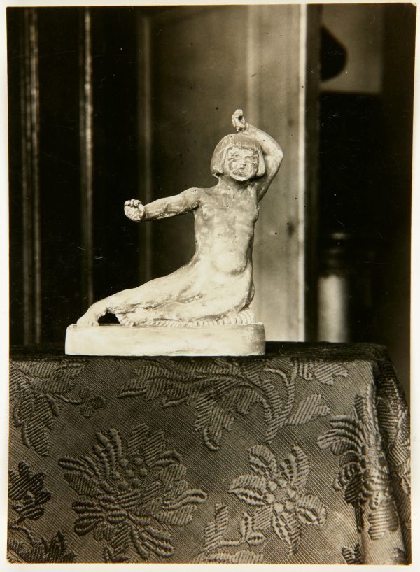 An image of Image of statue of a young girl stretching by Eleonore Lange
