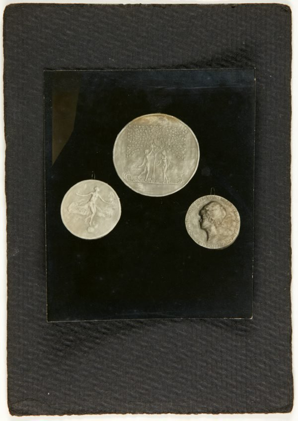 An image of Image of three medallions by Eleonore Lange