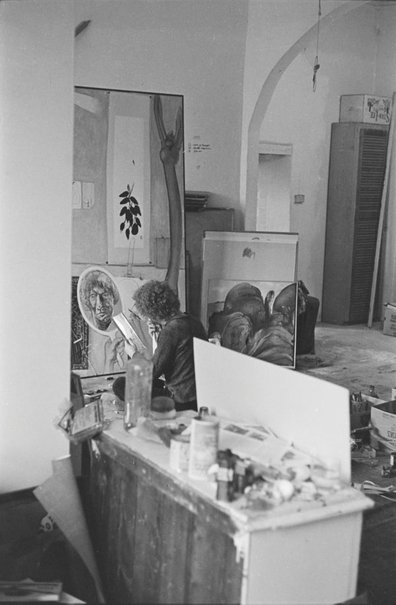 An image of Brett Whiteley working on 'Self portrait in the studio' 1977 by Robert Walker