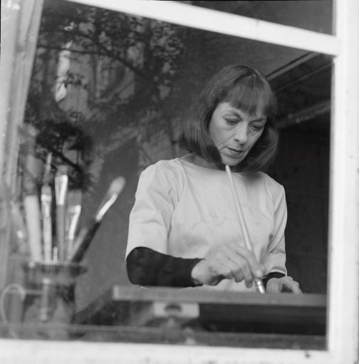 An image of Rosaleen Norton painting at her sister's flat in Kirribilli, Sydney by Robert Walker