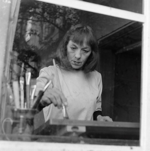 An image of Rosaleen Norton painting in her sister's flat at Kirribilli, Sydney by Robert Walker