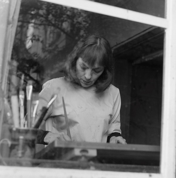 An image of Rosaleen Norton painting in her sister's flat at Kirribilli, Sydney