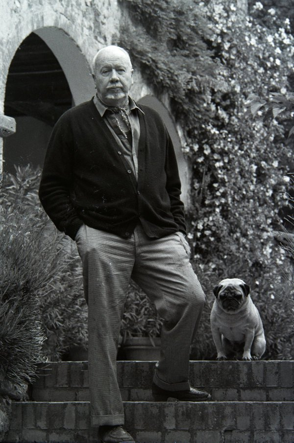 An image of Jeffrey Smart and his pet pug in the garden