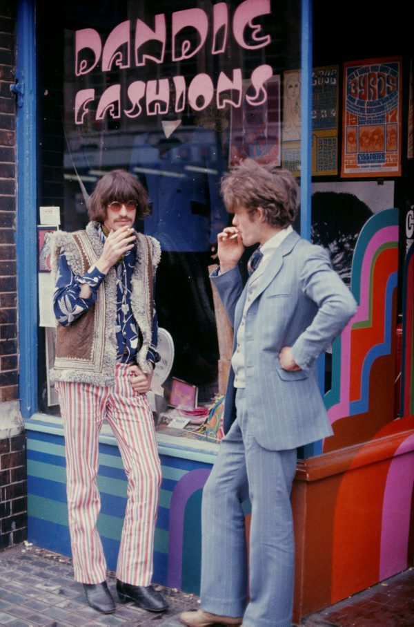 An image of Martin Sharp with friend outside Dandie Fashions, Chelsea, London