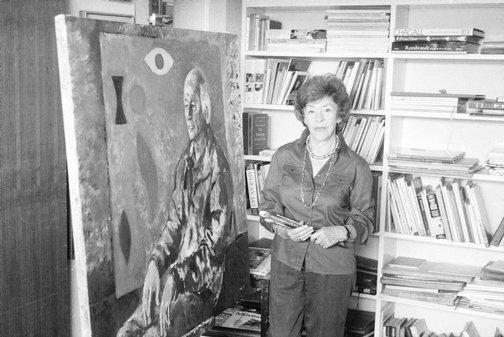 An image of Judy Cassab in her studio with her portrait of artist John Coburn by Robert Walker