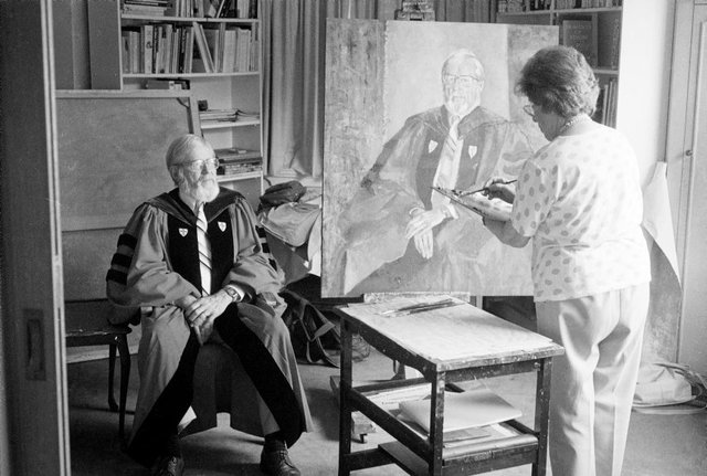 An image of Judy Cassab in her studio painting a portrait of the dean of Wesley College, University of Sydney