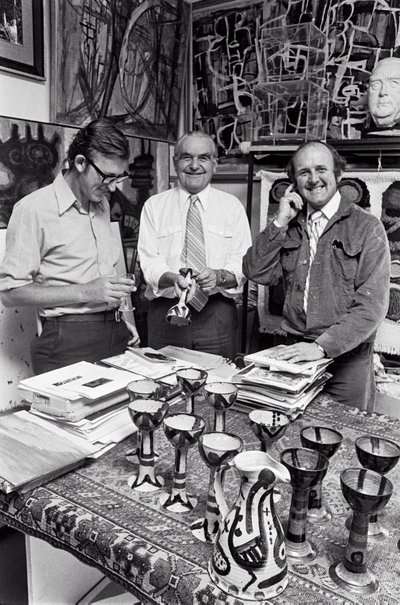 An image of David Aspden, Rudy Komon and John Olsen with ceramics decorated by Olsen by Robert Walker