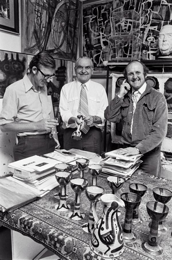 An image of David Aspden, Rudy Komon and John Olsen with ceramics decorated by Olsen
