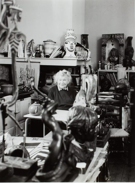 An image of Barbara Tribe in the kitchen of her home, 'The Studio', Sheffield, Cornwall by Unknown