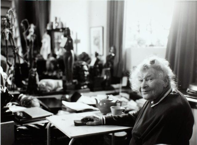 An image of Barbara Tribe in her home, 'The Studio', Sheffield, Cornwall
