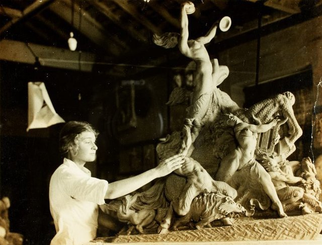 An image of Barbara Tribe with her work 'Bacchanalia' 1934, at East Sydney Technical College