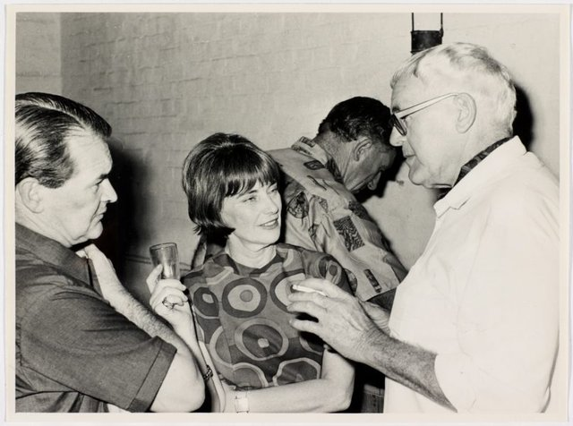 An image of Justin Lloyd, Ruth Julius and Hal Missingham at Sheila McDonald's party, Woolloomooloo