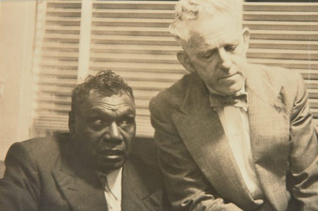 An image of Albert Namatjira and Rubery Bennett listening to an art broadcast