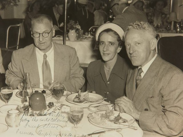 An image of Rubery and Vi Bennett at dinner with Frank Clune