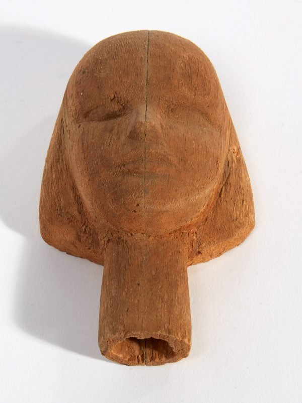 An image of Carved wooden head of a woman