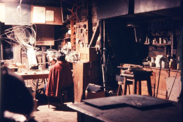 An image of Margel Hinder working in her studio