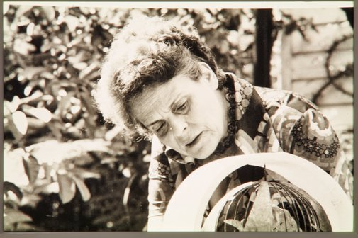An image of Margel Hinder with model for ''Northpoint fountain' 1975 by Margel Hinder in the garden by Unknown
