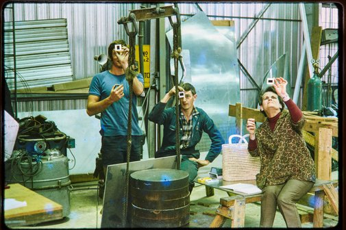 An image of Construction of Woden sculpture by Margel Hinder at Smithfield with fabricators Graham, Michael Snook and the artist looking at slides by Unknown