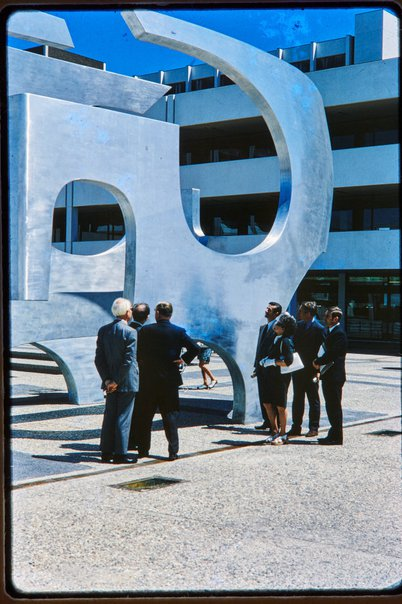 An image of Handover of completed Woden sculpture by Margel Hinder at Woden, Canberra with Margel Hinder and others by Unknown