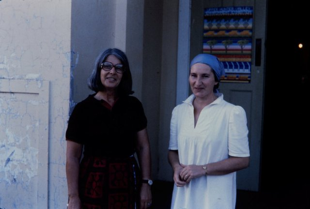 An image of Two women at the entrance to the 'Upper Hunter Valley environment exhibition', Denman