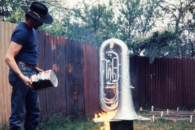 An image of Herbert Flugelman setting a euphonium on fire for his performance of 'Burning euphonium' 1972