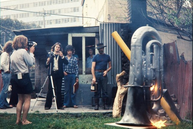 An image of Herbert Flugelman and burning euphonium for his performance of 'Burning euphonium' 1972
