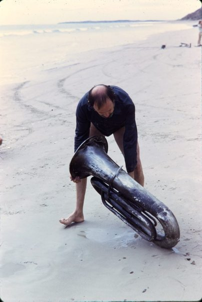 An image of Herbert Flugelman with euphonium on the beach for 'Euphonium Maslin Beach' 1974 by Unknown