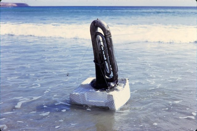 An image of Image of euphonium in the water for 'Euphonium Maslin Beach' 1974