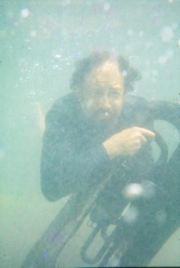 An image of Herbert Flugelman underwater with euphonium for 'Euphonium Maslin Beach' 1974