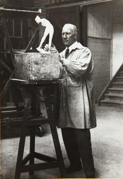 An image of Bertram Mackennal working on the plaster model for his sculpture 'Diana wounded' 1905 by Unknown