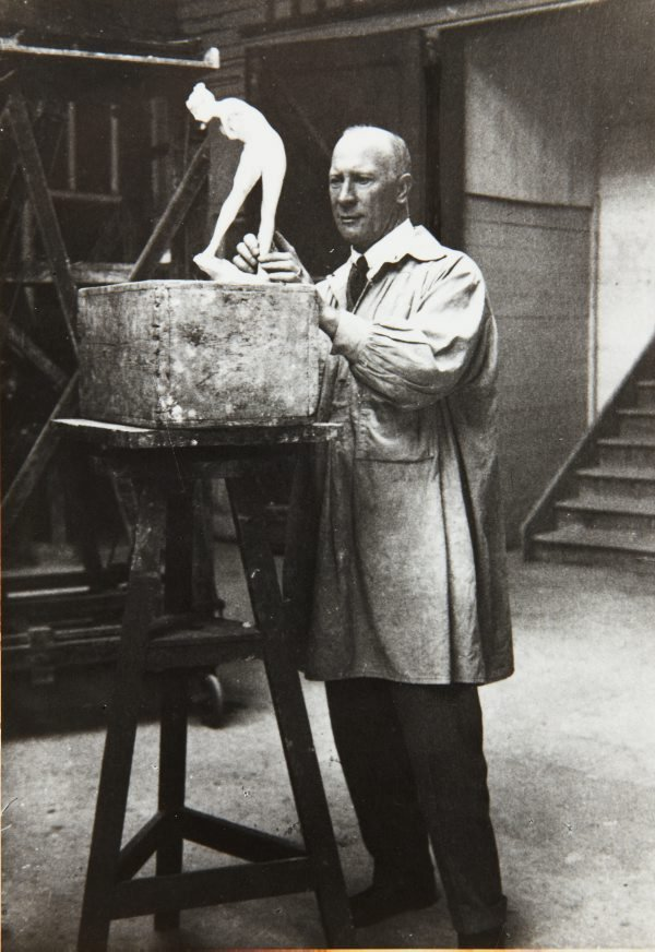 An image of Bertram Mackennal working on the plaster model for his sculpture 'Diana wounded' 1905