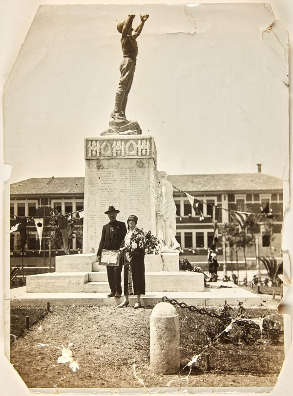 An image of Dora Ohlfsen in front of her Formia war memorial with the plaque awarding her the Freedom of the City