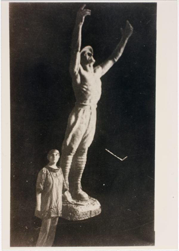 An image of Dora Ohlfsen with the plaster cast of 'Sacrifice', the central figure of her 1926 Formia war memorial, Italy