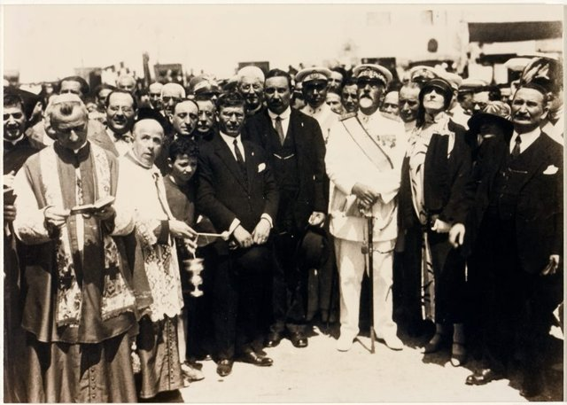 An image of The Archbishop of Gaeta, Admirals Simonetti and Sirianni with Dora Ohflsen and others at the dedication of the Formia war memorial by Dora Ohlfsen