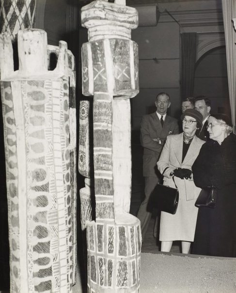 An image of Guests at the ceremony to mark the installation of the Tutini (Pukumani grave posts) at the Art Gallery of New South Wales by Max Dupain