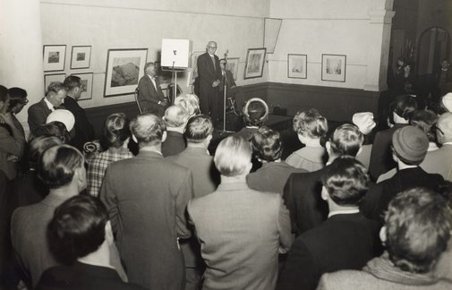 An image of Dr Scougall speaking at the installation of the Tutini (Pukumani grave posts) at the Art Gallery of New South Wales by Max Dupain