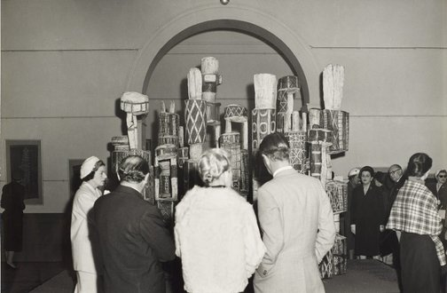 An image of Guests attending the ceremony to mark the installation of the Tutini (Pukumani grave posts) at the Art Gallery of New South Wales by Max Dupain