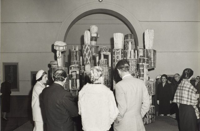 An image of Guests attending the ceremony to mark the installation of the Tutini (Pukumani grave posts) at the Art Gallery of New South Wales